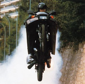 Flying with big motorcycle ala james bond