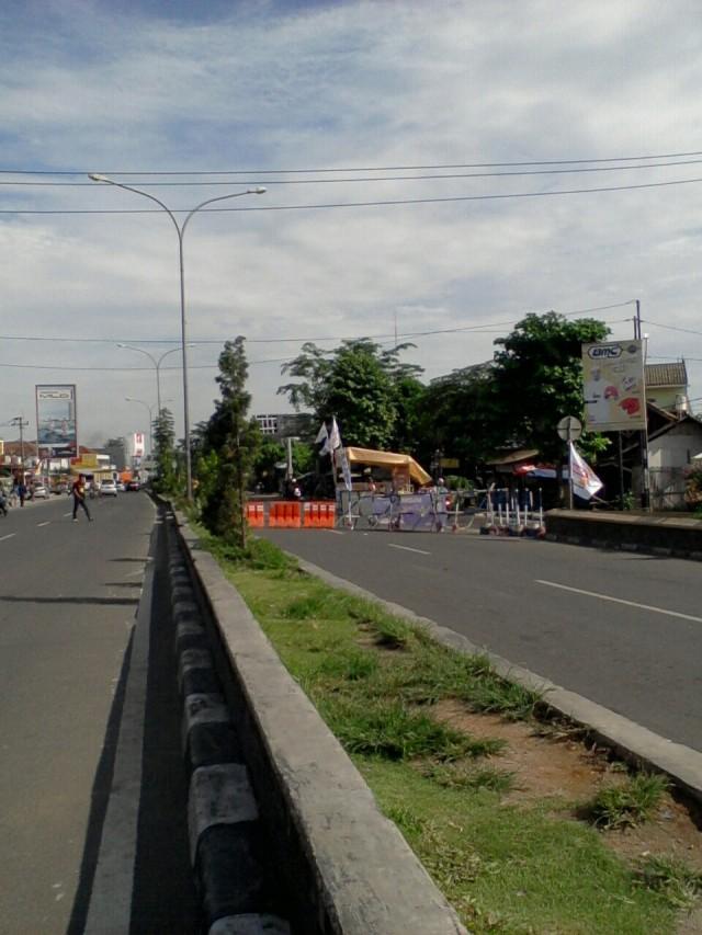 Portal jalan Tanjung Pura menuju Pangkal Perjuangan, diarahkan ke Lingkar Tanjung Pura
